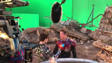 BTS: Spidey and Tony reunion. .. That random black dude running in the background and that random black dude skulking in the far background.
