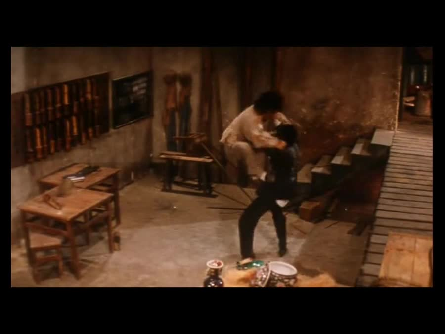 Drunken Master 2. Remember that Jackie does his own stunts.. Jackie's such a madman I wouldn't be surprised if that wasn't actual ethanol he was drinking there